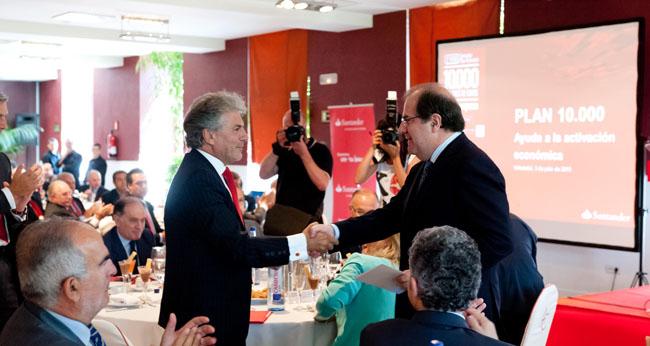 Herrera (izda.) en un acto del Santander.