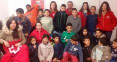 Niños y voluntarios del programa./SN