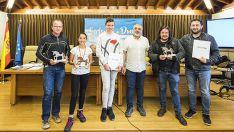 Los premiados con sus trofeos. /Afomic