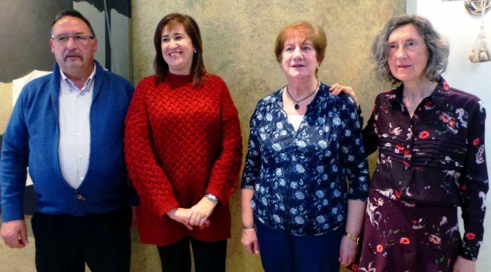 Los empleados homenajeados con Susana Andrés, gestora comercial en Soria.