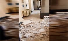 Desplome del falso techo en la lavandería de El Mirón