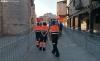 Voluntarios berlangueses en una de las calles de El Burgo. /SN